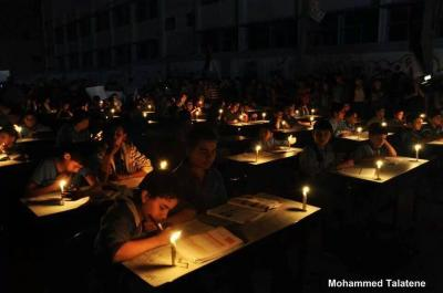gaza students study by candle light